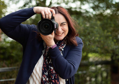 Woman holding camera to take a photo
