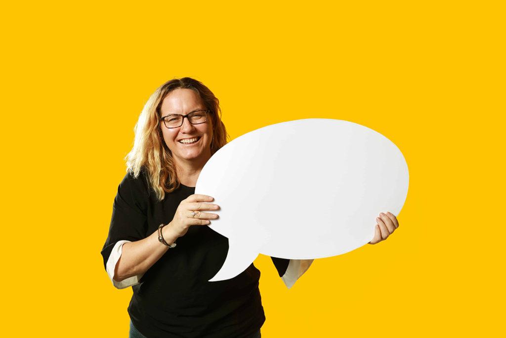 woman holding a giant speech bubble