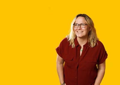 Woman in red against yellow background